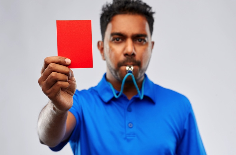 Red card, signalling penalty